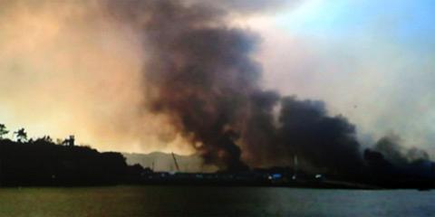 Triều Tiên nãpháo xuống đảo Yeonpyeong tháng 11/2010. Ảnh: SBS.