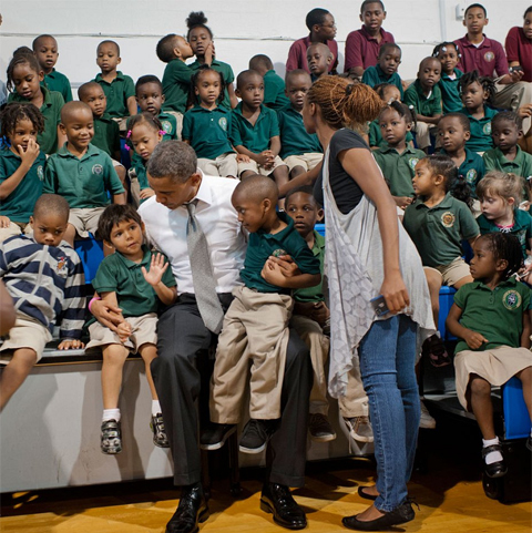 A little romance steals the show: President Barack Obama visited students at Daughter of Zion Jr. Academy in Delray Beach, Fla., on Tuesday, Oct. 23, 2012, during an unscheduled stop after a campaign event. But the big surprise was the pair of kissing students on the top bleacher