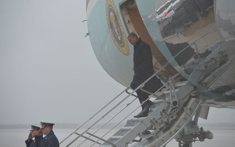 US President Barack Obama steps off Air Force One upon arrival at Andrews Air Force Base in Maryland. Obama cancelled his appearance at a campaign rally in Orlando, Florida and returned early to Washington, DC to monitor response to Hurricane Sandy.Picture: MANDEL NGAN/AFP/Getty Images