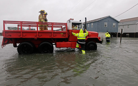 A Dare County utility worker checks with the Kitty Hawk Fire Department as they patrol flooded streets in Kitty Hawk, North CarolinaPicture: Gerry Broome/AP