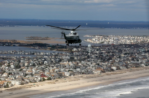 Marine One with US President Barack Obama on board flies over damage area in Seaside Heights, New Jersey, on October 31, 2012.