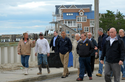 US President Barack Obama (C) visits a neighborhood on October 31, 2012 in Brigantine, New Jersey, hit hard by Hurricane Sandy. Americans sifted through the wreckage of superstorm Sandy on Wednesday as millions remained without power.