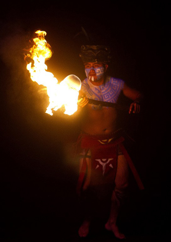 "A Mexican wearing a pre-Hispanic Mayan costume plays with a ball of fire in a recreation at Xcaret Park in Playa del Carmen in Quintana Roo state, Mexico on December 18, 2012, during preparations for the celebration of the end of the Maya Long Count Calendar --Baktun 13-- and the beginnig of a new era. Mexico is one of five countries preparing to observe the date on December 21, which marks the end of a more than 5,000-year era, according to the Mayan ""Long Count"" calendar, which began in 3114 BC"