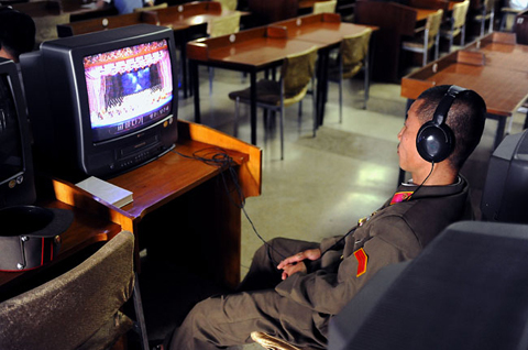 The Study Hall also offers a limited selection of carefully chosen music videos, audio cassettes and CDs. Here a North Korean soldier listens to an opera performance.
