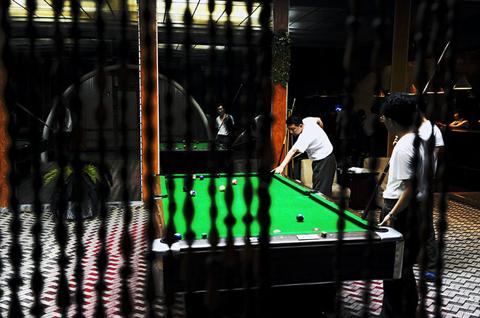 Men play billiard in Pyongyang.