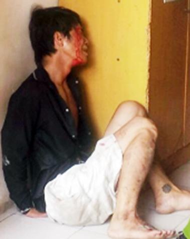Tên cướp bị nữ sinh viên bắt giữ. Ảnh: An Nhơn