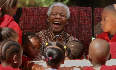 Nelson Mandela enjoying his 89th birthday celebrations at the Nelson Mandela Children's Fund in Johannesburg. Photograph: Denis Farrell/AP