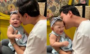 Quang Vinh dỗ cháu gái cười nắc nẻ