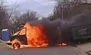 Xe tải cháy lao xuống đường