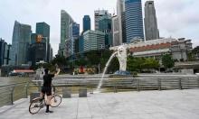 Singapore tranh cãi về 'sống chung với Covid-19'