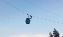 Đu dây cứu nhóm người kẹt trong cáp treo cao 30 m