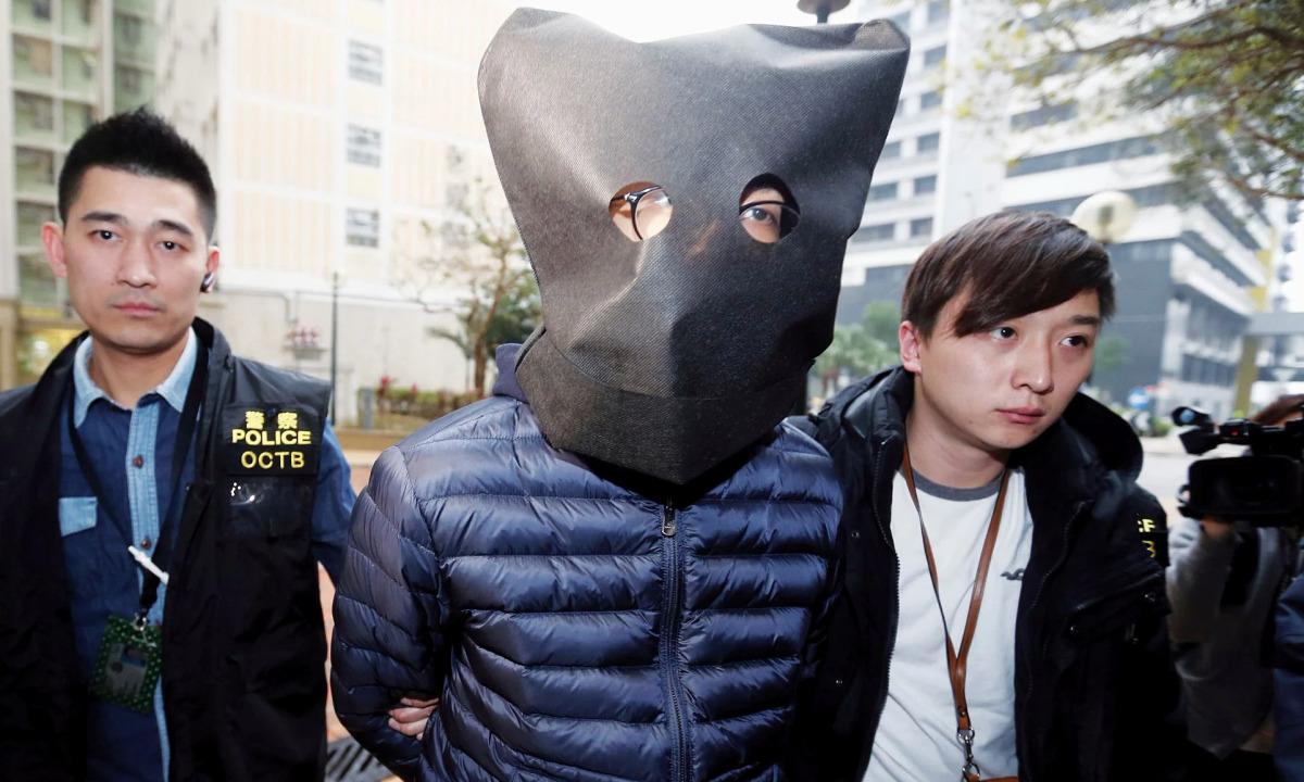 Vì sao cảnh sát trùm mũ đen vào đầu người bị bắt?